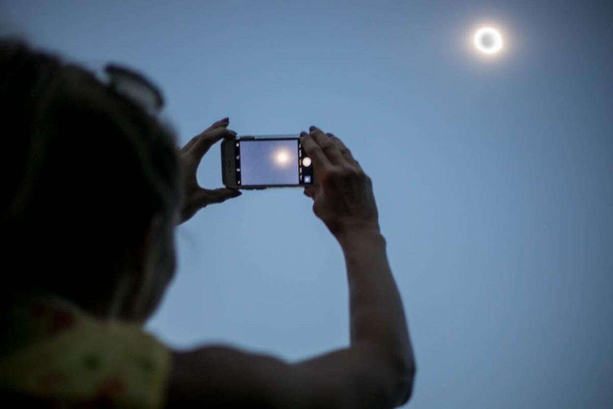 image of child viewing solar eclipse